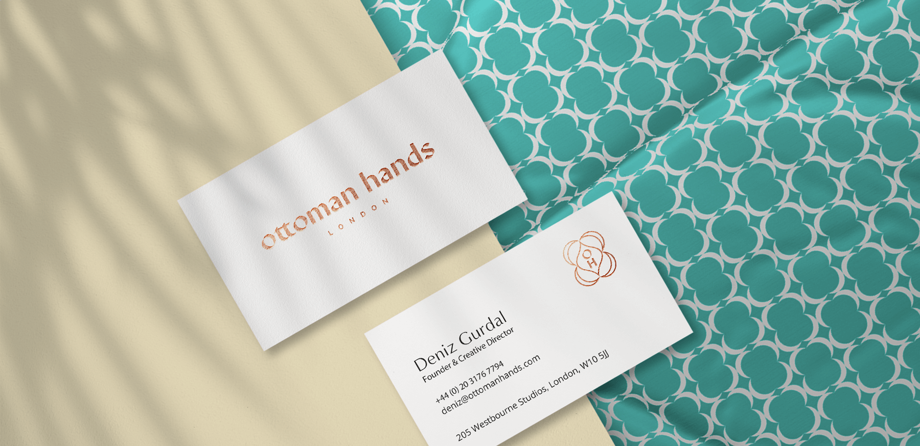 Business Cards for Ottoman Hands in a mock up on a textured material