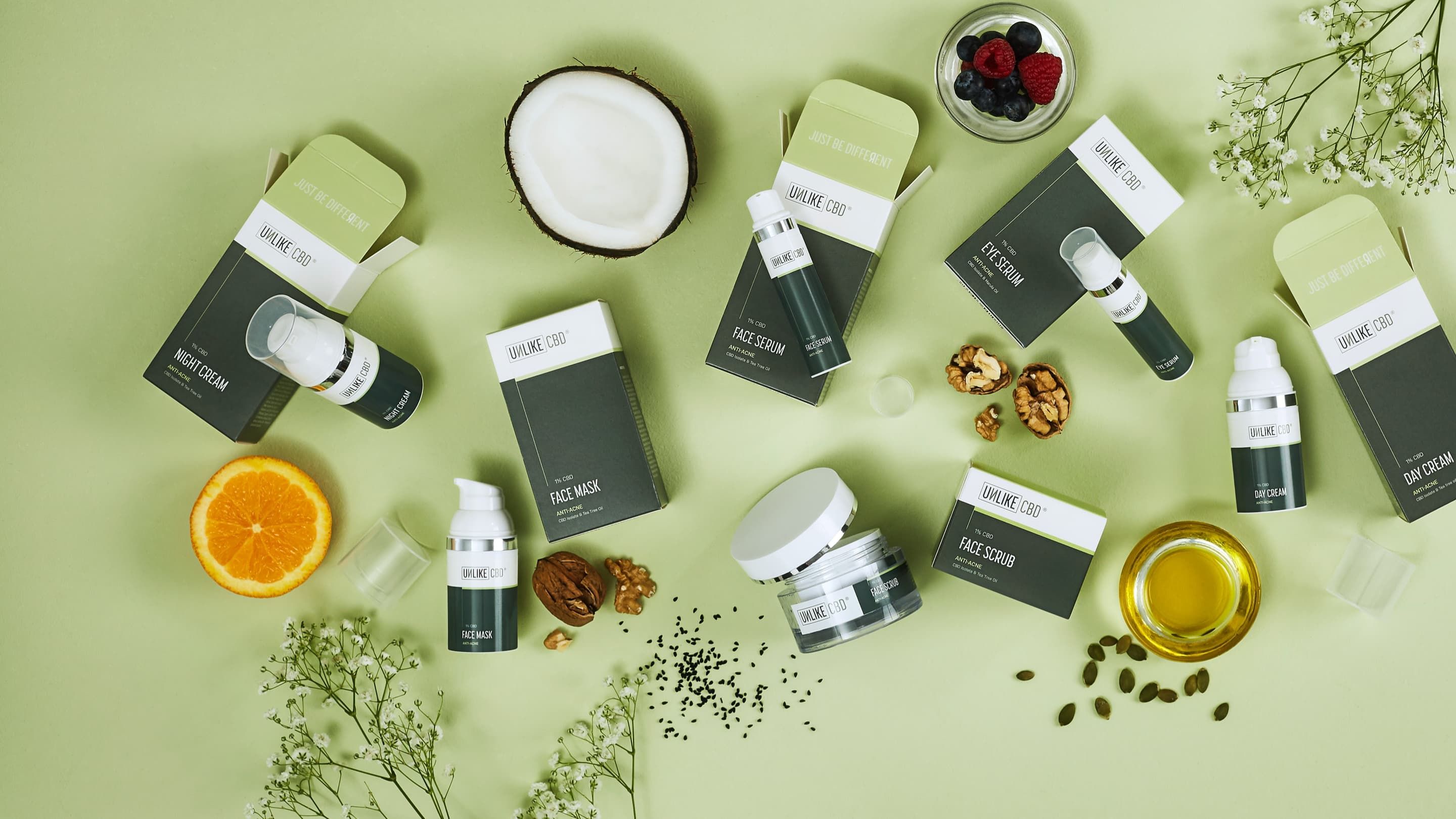 Multiple Unlike CBD products as a flat lay including fruit and berries